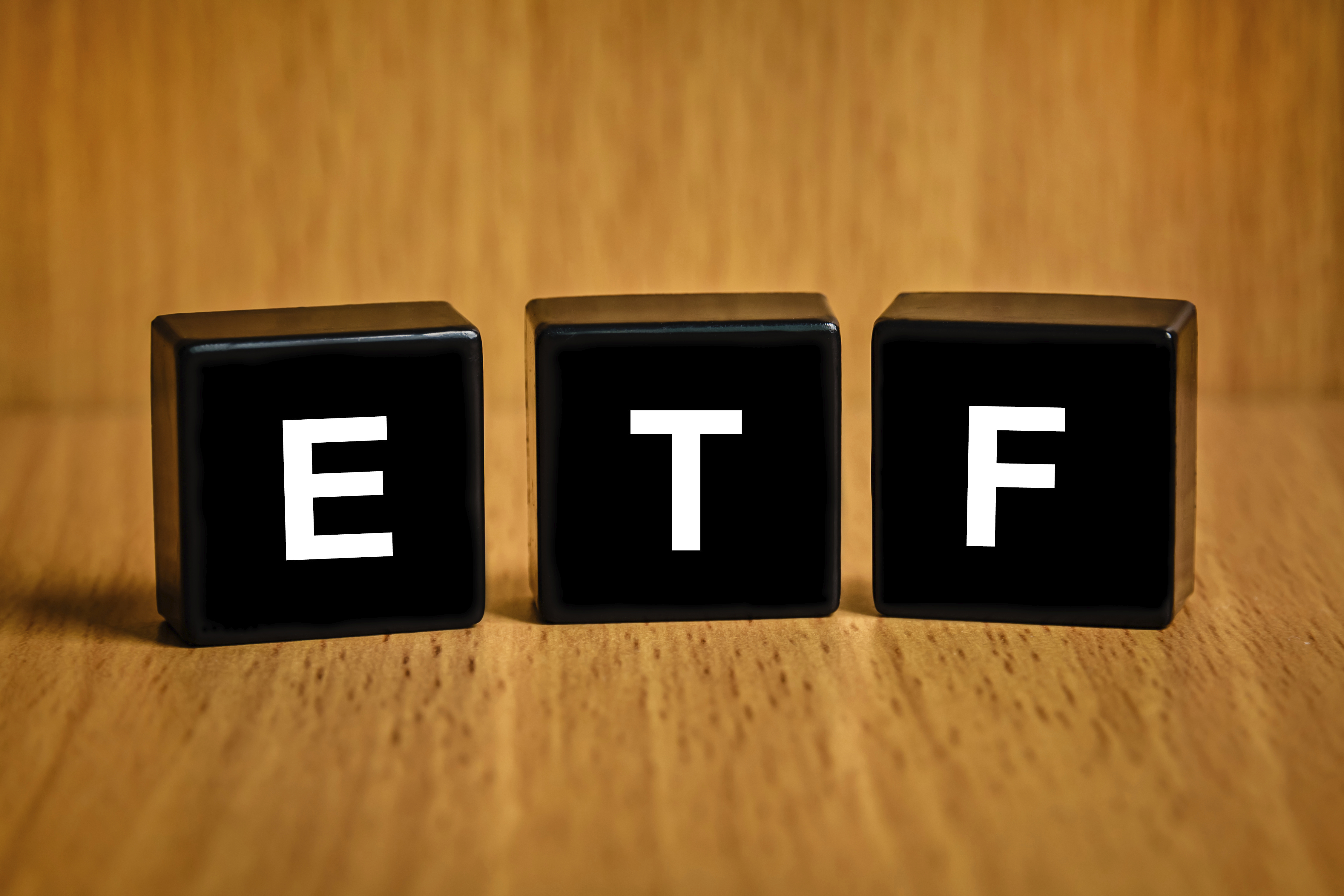 ETF or Exchange Traded Fund text on black block