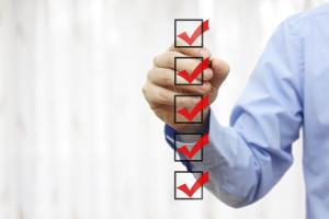 businessman checking final  mark on checklist