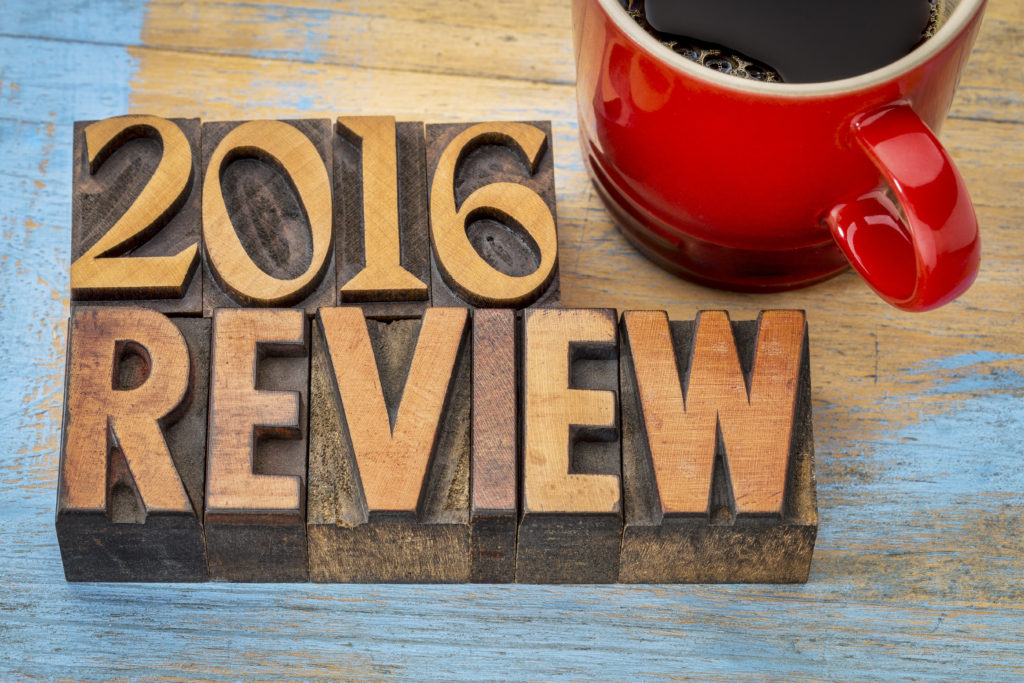 2016 review banner - text in vintage letterpress wood type block with a cup of coffee